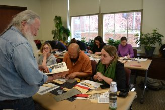 Lilly Library book conservator Jim Canary discusses palm leaf production with Katherine Tachau, Kalzang Dorjee Bhutia, and Amy Holmes-Tagchungdarpa at the Mellon Sawyer workshop