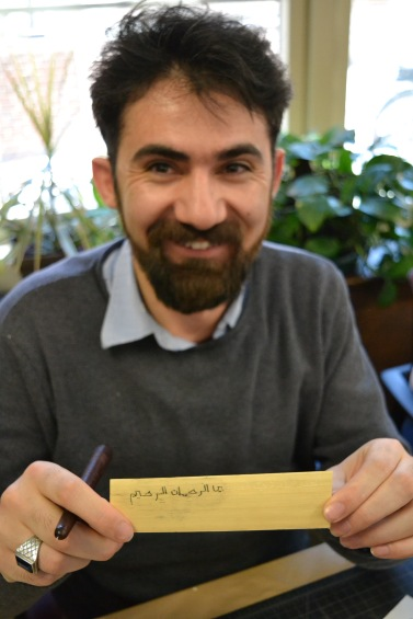 PhD student Cuma Ozkan shows off his palm-leaf manuscript leaf